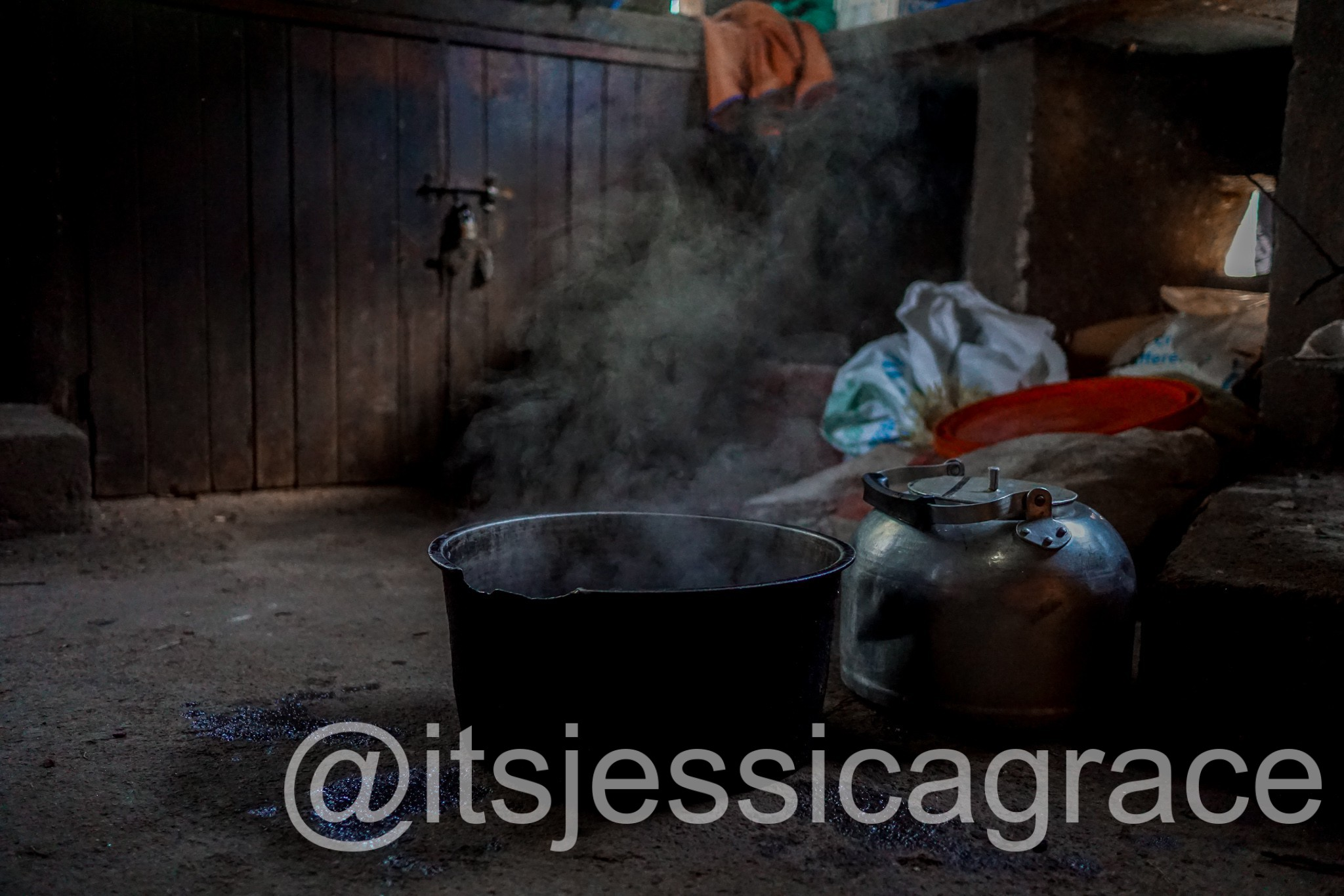 large cooking pot on kitchen floor in a steamy Ugandan school kitchen