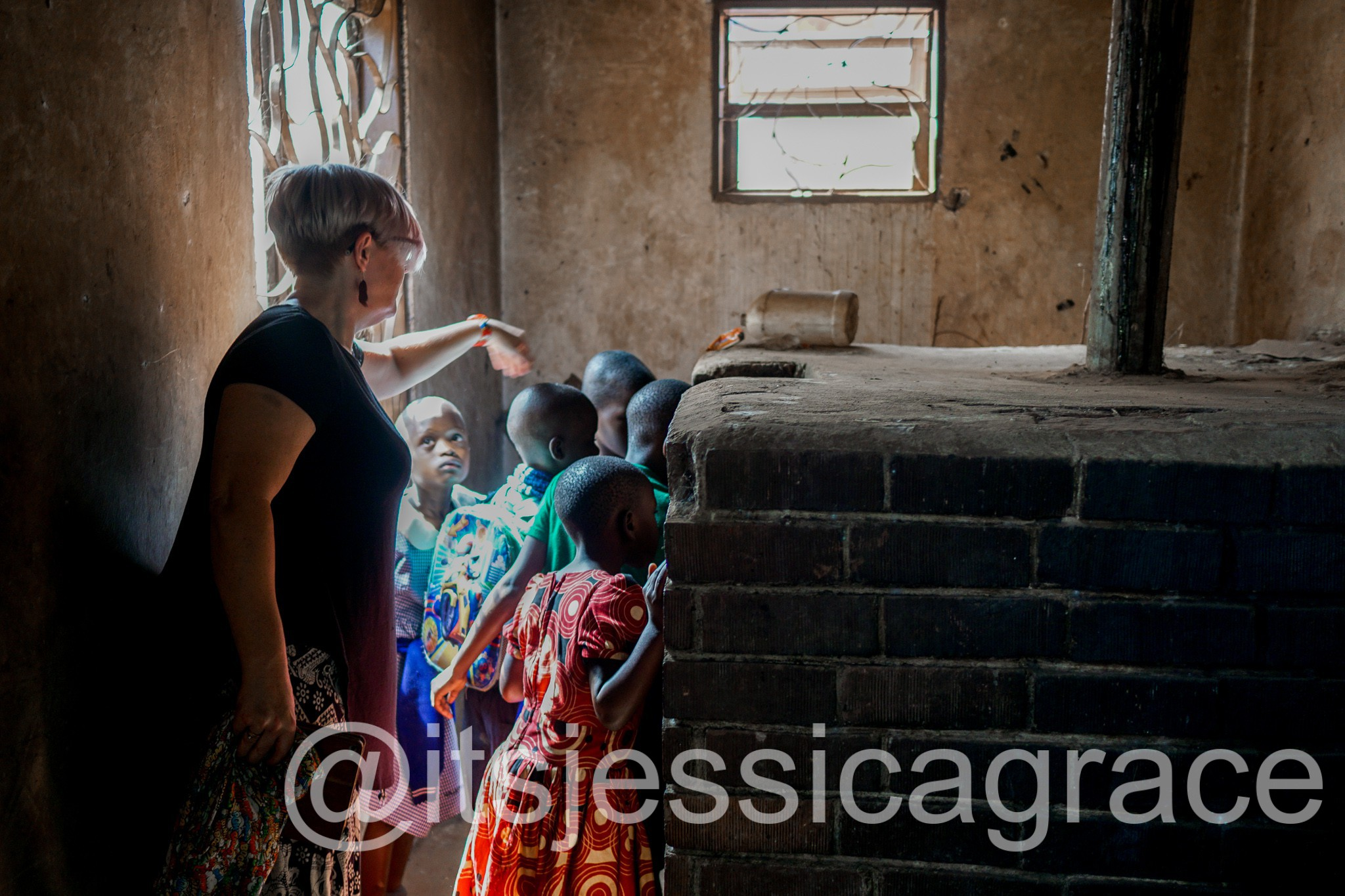 Pupils at the Uganda School for the Deaf exploring the large baking ovens with Aunty Flo